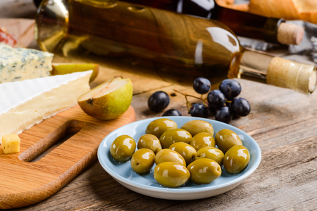 Green olives on blue plate 写真素材