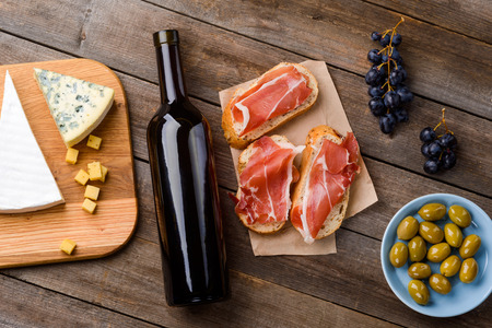 Cheese, wine, meat and fruits