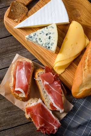 Meat, bread and various cheeses Stock Photo