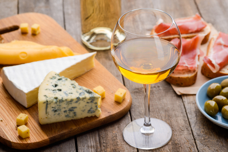 Cheese, wine, meat and olives