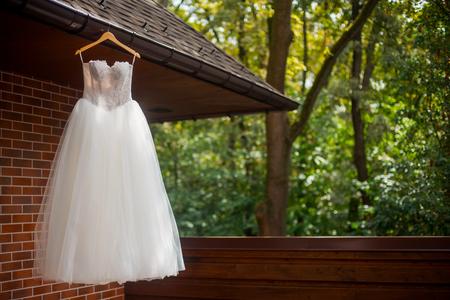 White wedding dress on hanger Reklamní fotografie - 112277662