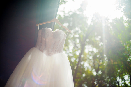 Bridal gown hanging outdoors