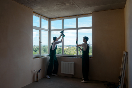Two men doing internal works