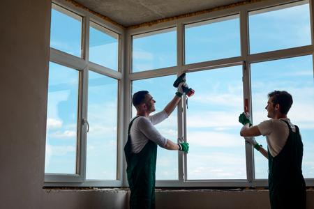 Men are installing a window