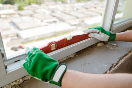 Hands holding a carpenter level