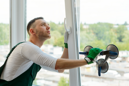 Handyman is repairing a window Stock Photo