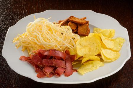 Various snacks on white plate