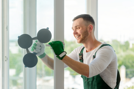 Man installing a window unit