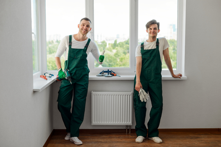 Two colleagues doing home repair