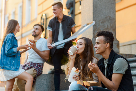Young people eating junk food Stock Photo