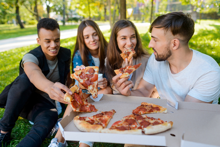 Group of friends taking pizza Stockfoto