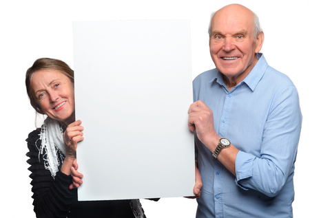 Grandparents pose with empty placard