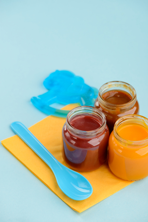Baby food, teether and spoon