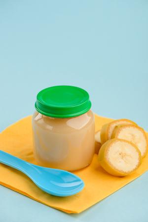 Banana puree, slices and spoon