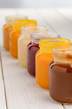 Jars full of fruit purees Stock Photo