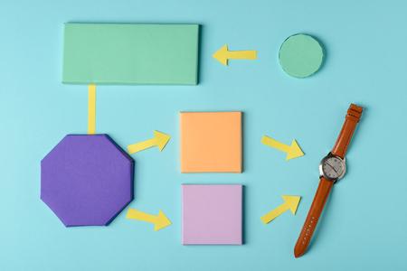 Analog watch and paper blocks 스톡 콘텐츠