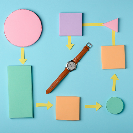Colorful paper blocks and watch 스톡 콘텐츠