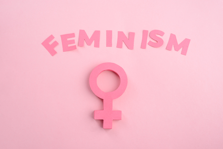 Feminism lettering and female sign Stock Photo