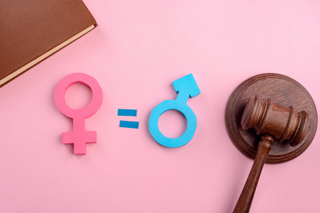 Female, male signs and gavel