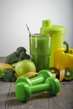 Green dumbbells and food