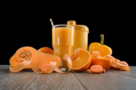 Orange food on wooden table Stock Photo