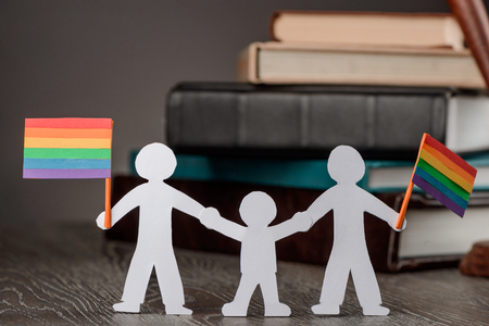 Happy gay couple with child Stock Photo