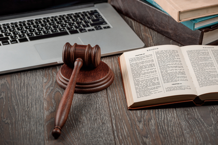 Laptop, gavel and Holy Bible