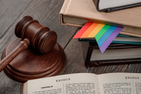 Judges gavel, book and rainbow