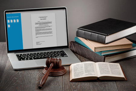 Laptop, gavel and books