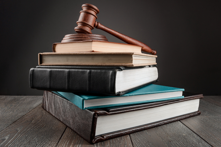 Judges gavel on top of a stack of books. Legal knowledge and philosophy, learning and teaching jurisprudence.