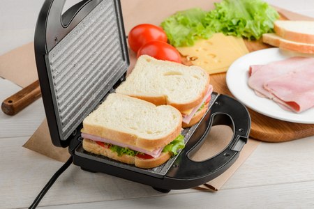 Uncooked sandwiches in panini press