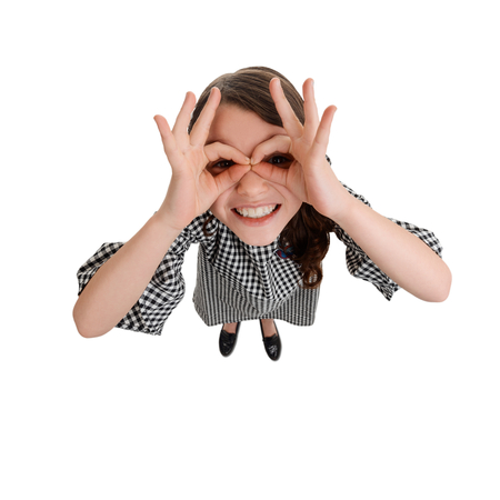 Funny girl making finger glasses