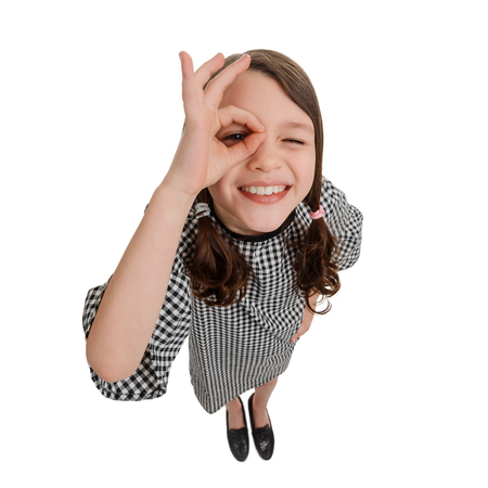 Girl with alright hand sign Stock Photo