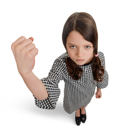 Girl showing a big fist Stock Photo