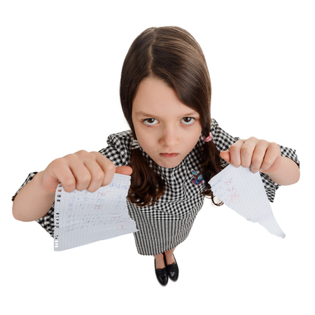 Angry girl tore her homework Stock Photo