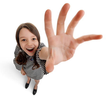 Girl reaching out her hand Stock Photo