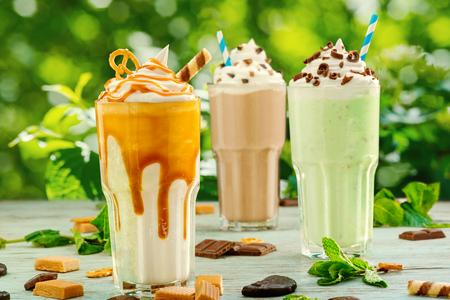 Assorted milkshakes on restaurant terrace Stock Photo