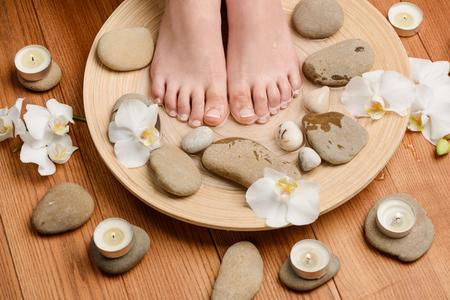 Womens feet in warm bath