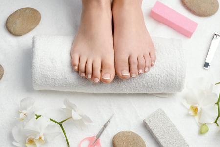 Female feet on towel roll