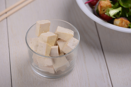 Portion of firm Tofu cubes Stock Photo