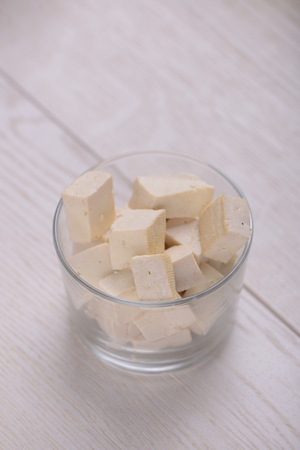 Tofu cubes in a glass Stock Photo