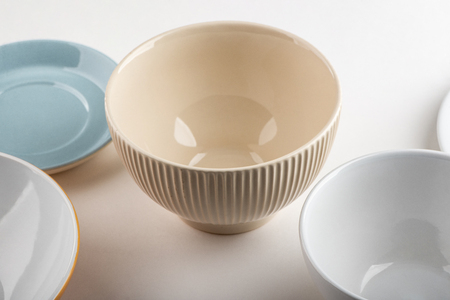 Beige ribbed mixing bowl Stock Photo