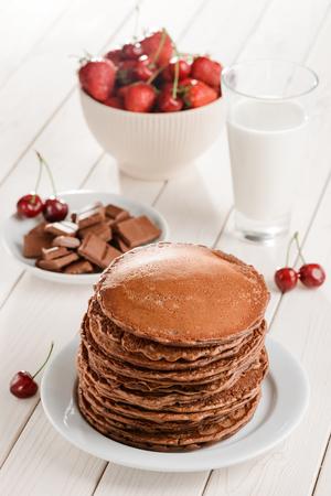 Pile of pancakes, chocolate, berries