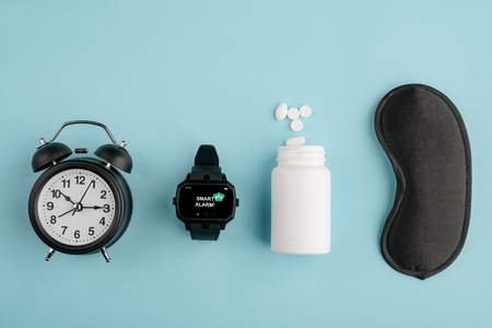 Clock, watch, pills and mask Stock Photo
