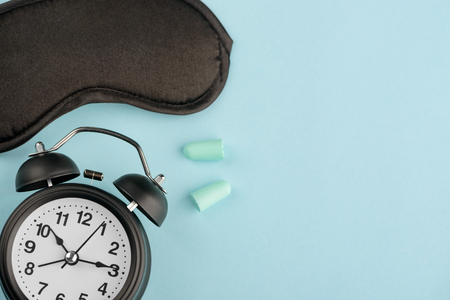 Clock, eye mask and earplugs