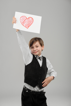 Young boy with painted heart