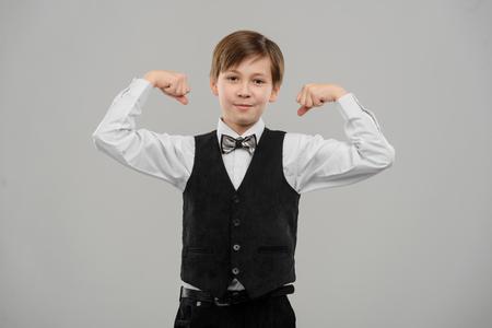 Little boy bragging about biceps