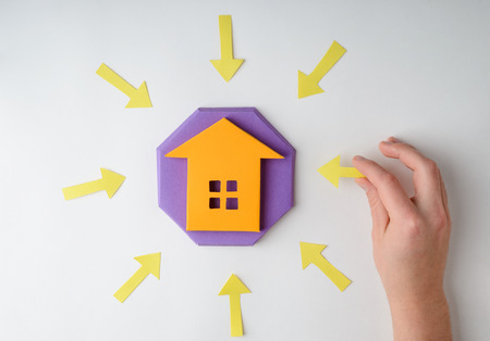House figurine and arrows