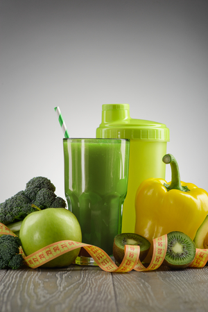 Green smoothie and ingredients Stock Photo