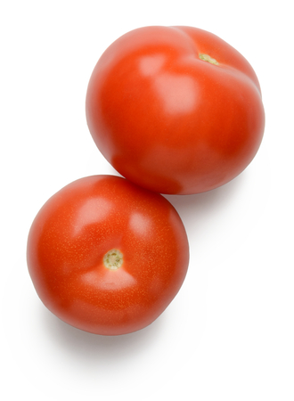 Two red tomatoes on white